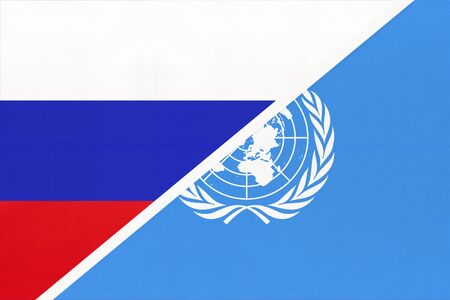 Russia or Russian Federation national fabric flag from textile vs United Nations UN official flag. Sign of the international community of world.