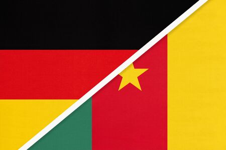 Federal Republic of Germany vs Cameroon, symbol of two national flags from textile. Relationship, partnership and championship between European and African countries.