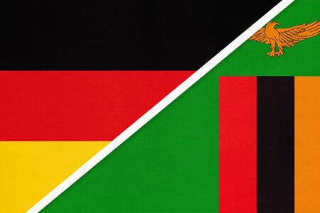 Federal Republic of Germany vs Zambia, symbol of two national flags from textile. Relationship, partnership and championship between European and African countries.