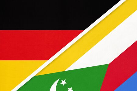 Federal Republic of Germany vs Union of the Comoros, symbol of two national flags from textile. Relationship, partnership and championship between European and African countries.