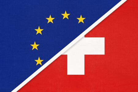 European Union or EU vs Switzerland or Swiss Confederation, national flag from textile. Symbol of the Council of Europe association. Europe championship