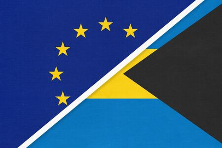 European Union or EU vs Commonwealth of The Bahamas national flag from textile. Symbol of the Council of Europe association opposite American country. Europe championship