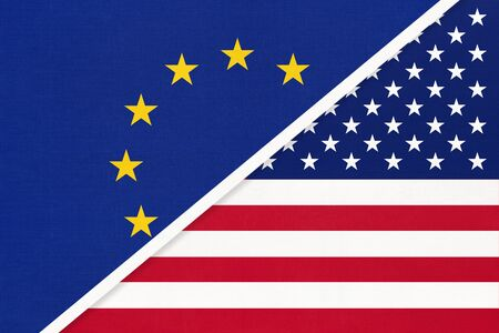 European Union or EU vs United States of America or USA national flag from textile. Symbol of the Council of Europe association opposite American country. Europe championship