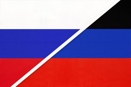 Russia or Russian Federation and Donetsk People's Republic or DNR, symbol of two national flags from textile. Relationship, partnership and economic between european countries. Stock Photo