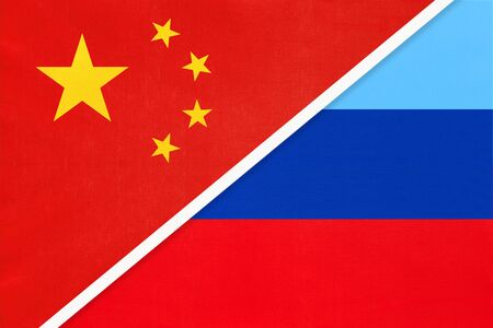 People's Republic of China or PRC and Luhansk Republic or LNR, national flag from textile. Relationship, partnership and economic between two asian and european countries.