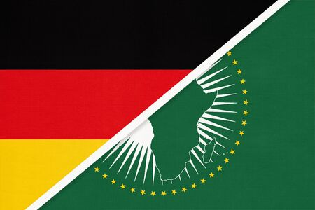 Republic of Germany and African Union national flag from textile. Symbol of the assembly of the African continent.