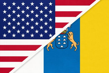 United States of America or USA and Canary Islands national flag from textile. Relationship, partnership and economic between two american and european countries.