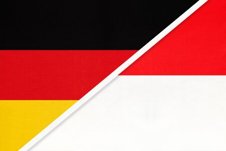 Federal Republic of Germany and Indonesia, symbol of two national flags from textile. Relationship, partnership and championship between European and Asian countries. Фото со стока