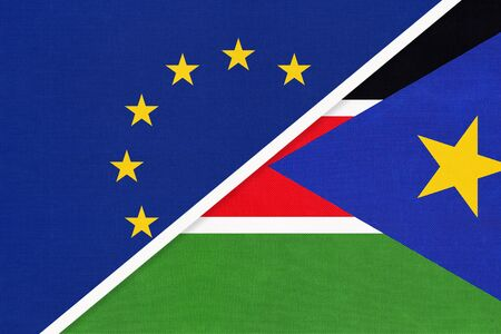 European Union or EU and South Sudan national flag from textile. Symbol of the Council of Europe association opposite African country. Europe championship
