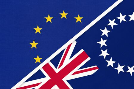 European Union or EU and Cook Islands national flag from textile. Symbol of the Council of Europe association. Europe championship. Oceania country.