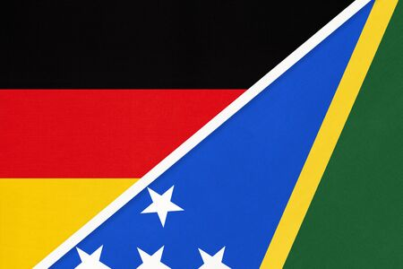 Federal Republic of Germany and Solomon Islands, symbol of two national flags from textile. Relationship, partnership and championship between European and Oceania countries.