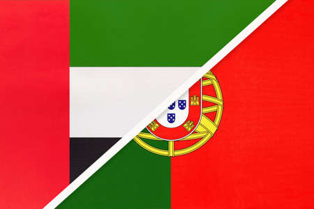 United Arab Emirates or UAE and Portugal or Portuguese Republic, symbol of two national flags from textile. Relationship, partnership and championship between European and Asian countries. Stock Photo