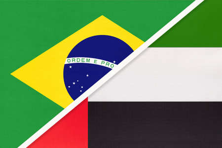 Republic of Brazil and United Arab Emirates or UAE, symbol of two national flags from textile. Relationship, partnership and championship between Asian and American countries.