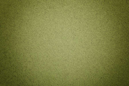 Texture of vintage light green paper background with matte vignette. Structure of olive kraft cardboard with frame. Felt gradient backdrop, closeup. Archivio Fotografico - 151191568