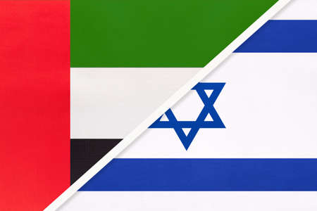 United Arab Emirates or UAE and Israel, symbol of national flags from textile. Relationship, partnership and championship between two Asian countries.