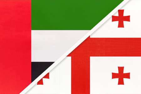 United Arab Emirates or UAE and Georgia, symbol of national flags from textile. Relationship, partnership and championship between two Asian countries.