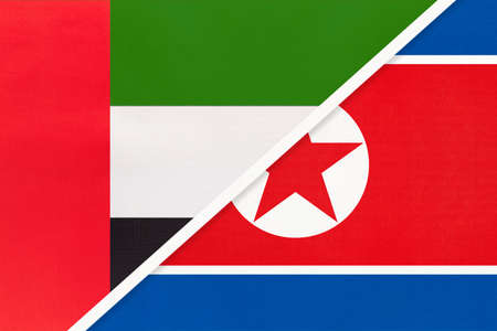 United Arab Emirates or UAE and North Korea or DPRK, symbol of national flags from textile. Relationship, partnership and championship between two Asian countries.