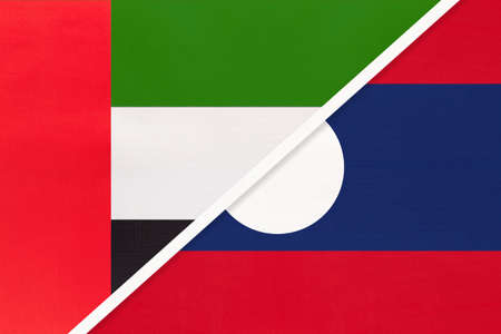 United Arab Emirates or UAE and Laos, symbol of national flags from textile. Relationship, partnership and championship between two Asian countries.