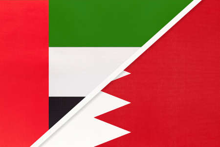 United Arab Emirates or UAE and Bahrain, symbol of national flags from textile. Relationship, partnership and championship between two Asian countries. 版權商用圖片