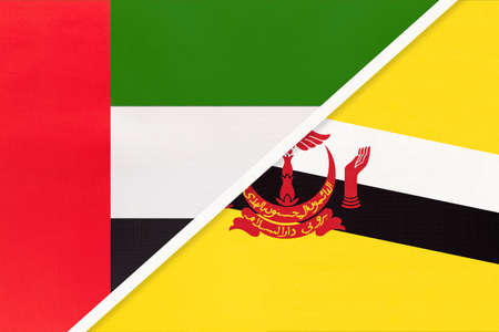 United Arab Emirates or UAE and Brunei, symbol of national flags from textile. Relationship, partnership and championship between two Asian countries. 版權商用圖片