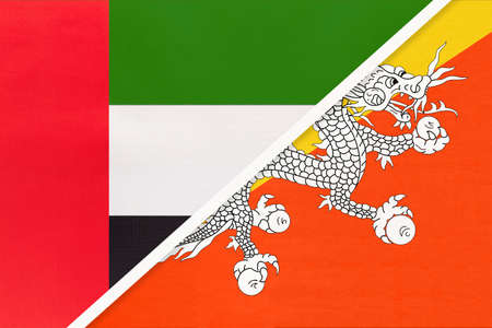 United Arab Emirates or UAE and Bhutan, symbol of national flags from textile. Relationship, partnership and championship between two Asian countries. Archivio Fotografico