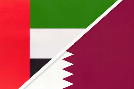 United Arab Emirates or UAE and Qatar, symbol of national flags from textile. Relationship, partnership and championship between two Asian countries. Archivio Fotografico