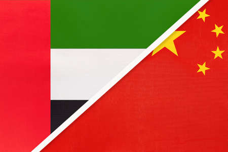 United Arab Emirates or UAE and China or PRC, symbol of national flags from textile. Relationship, partnership and championship between two Asian countries.
