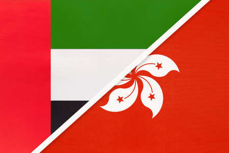 United Arab Emirates or UAE and Hong Kong, symbol of national flags from textile. Relationship, partnership and championship between two Asian countries. Archivio Fotografico