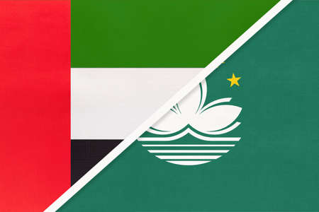 United Arab Emirates or UAE and Macau or Macao, symbol of national flags from textile. Relationship, partnership and championship between two Asian countries.
