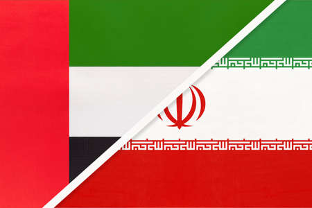 United Arab Emirates or UAE and Iran or Persia, symbol of national flags from textile. Relationship, partnership and championship between two Asian countries.