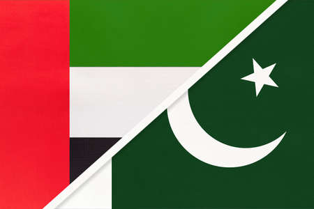 United Arab Emirates or UAE and Pakistan, symbol of national flags from textile. Relationship, partnership and championship between two Asian countries.