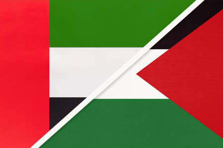 United Arab Emirates or UAE and Palestine, symbol of national flags from textile. Relationship, partnership and championship between two Asian countries.