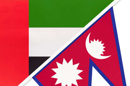 United Arab Emirates or UAE and Nepal, symbol of national flags from textile. Relationship, partnership and championship between two Asian countries.