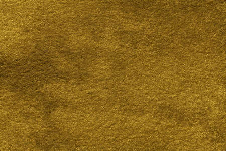 Abstract art background golden color. Watercolor painting on canvas with gradient. Texture of old yellow and ocher paper, closeup. Texture backdrop, macro. Archivio Fotografico
