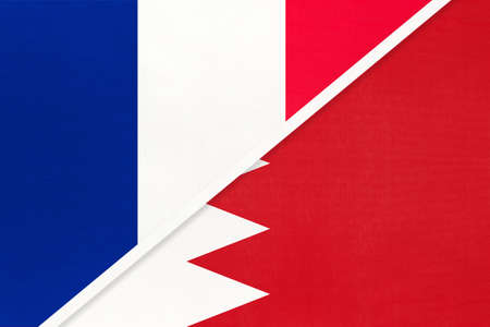 French Republic or France and Bahrain, symbol of two national flags from textile. Relationship, partnership and championship between European and Asian countries.