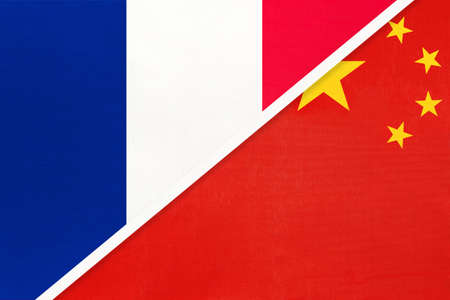 French Republic or France and China or PRC, symbol of two national flags from textile. Relationship, partnership and championship between European and Asian countries. Archivio Fotografico - 151447080