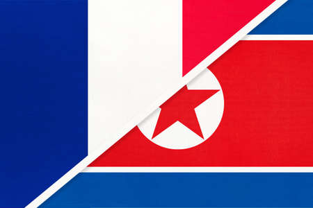 French Republic or France and North Korea or DPRK, symbol of two national flags from textile. Relationship, partnership and championship between European and Asian countries. Archivio Fotografico - 151452595