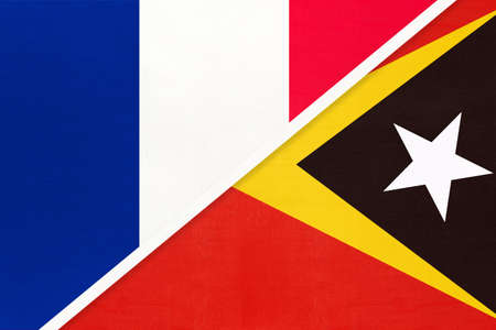 French Republic or France and East Timor, symbol of two national flags from textile. Relationship, partnership and championship between European and Asian countries.