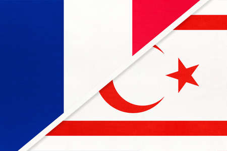 French Republic or France and Northern Cyprus or TRNC, symbol of two national flags from textile. Relationship, partnership and championship between European and Asian countries.