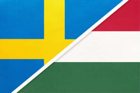 Kingdom of Sweden and Hungary, symbol of national flags from textile. Relationship, partnership and championship between two European countries.