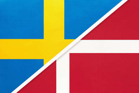 Kingdom of Sweden and Denmark, symbol of national flags from textile. Relationship, partnership and championship between two European countries.