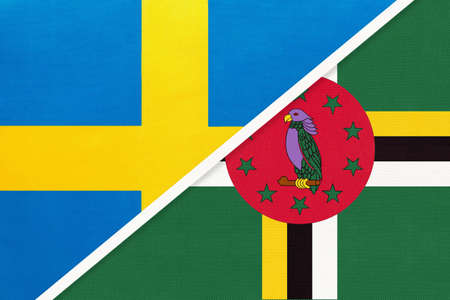 Kingdom of Sweden and Dominica, symbol of national flags from textile. Relationship, partnership and championship between European and American countries. Standard-Bild