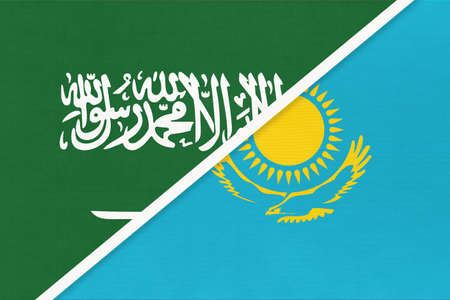 Saudi Arabia and Kazakhstan, symbol of national flags from textile. Relationship, partnership and championship between two Asian countries. 版權商用圖片