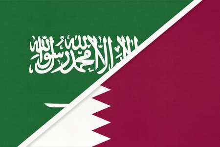 Saudi Arabia and Qatar, symbol of national flags from textile. Relationship, partnership and championship between two Asian countries.