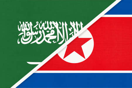 Saudi Arabia and North Korea or DPRK, symbol of national flags from textile. Relationship, partnership and championship between two Asian countries.