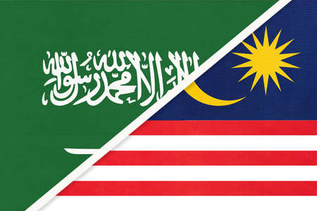 Saudi Arabia and Malaysia, symbol of national flags from textile. Relationship, partnership and championship between two Asian countries. 版權商用圖片