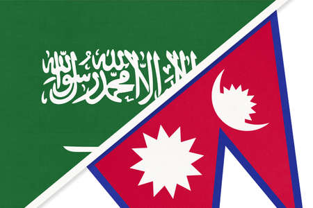 Saudi Arabia and Nepal, symbol of national flags from textile. Relationship, partnership and championship between two Asian countries. 版權商用圖片