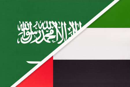 Saudi Arabia and United Arab Emirates or UAE, symbol of national flags from textile. Relationship, partnership and championship between two Asian countries.