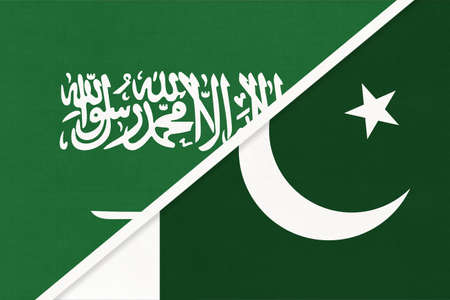Saudi Arabia and Pakistan, symbol of national flags from textile. Relationship, partnership and championship between two Asian countries.