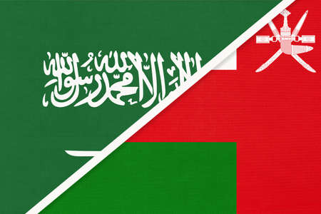 Saudi Arabia and Sultanate of Oman, symbol of national flags from textile. Relationship, partnership and championship between two Asian countries.